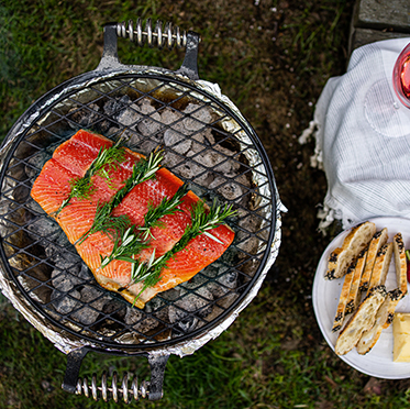 sockeye fillet with rosemary on a grill